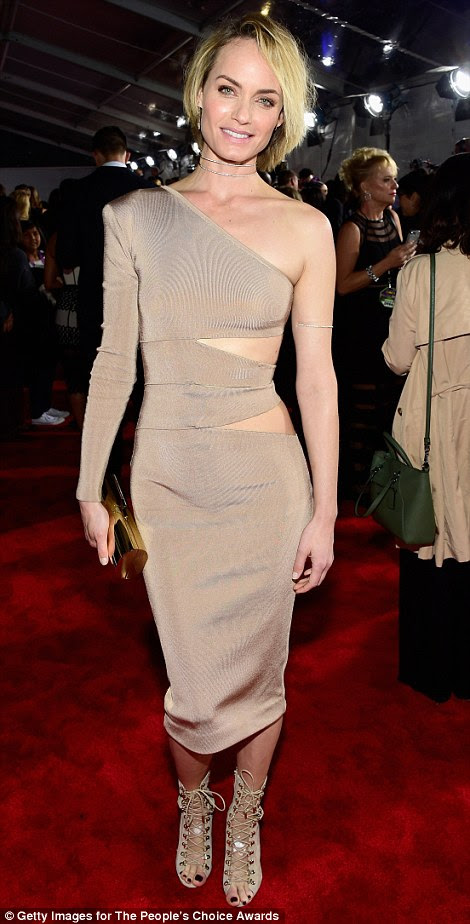 Daring to bare: Amber Valletta managed to pull off a skintight one-shouldered dress with striking cut-outs