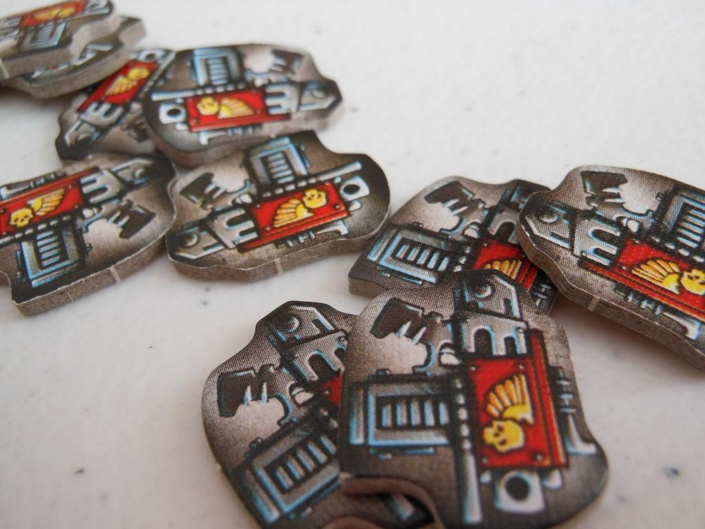 Close up view of Space Hulk: Death Angel support tokens, each designed to look like a space marine bolter gun.