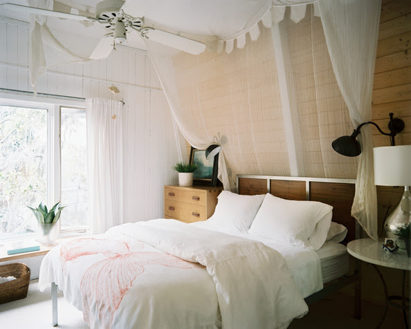 Bedroom - A neutral guest room with a canopy of white muslin