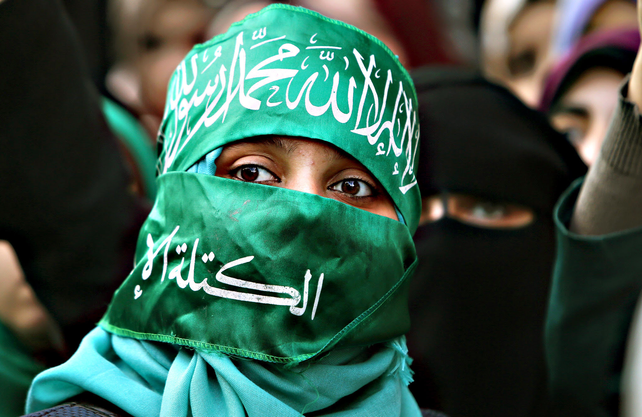 A Palestinian woman supporting the Hamas attends a rally in Gaza City on December 14, 2015, to mark the ruling Islamist movement's 28th birthday
