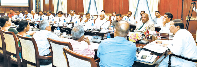 President Maithripala Sirisena at yesterday's meeting with senior Ministers and officials.