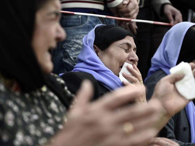 A woman cries over the loss of her daughter during a protest in support of Iraqi ethnic Yazidis in Hanover, Germany.