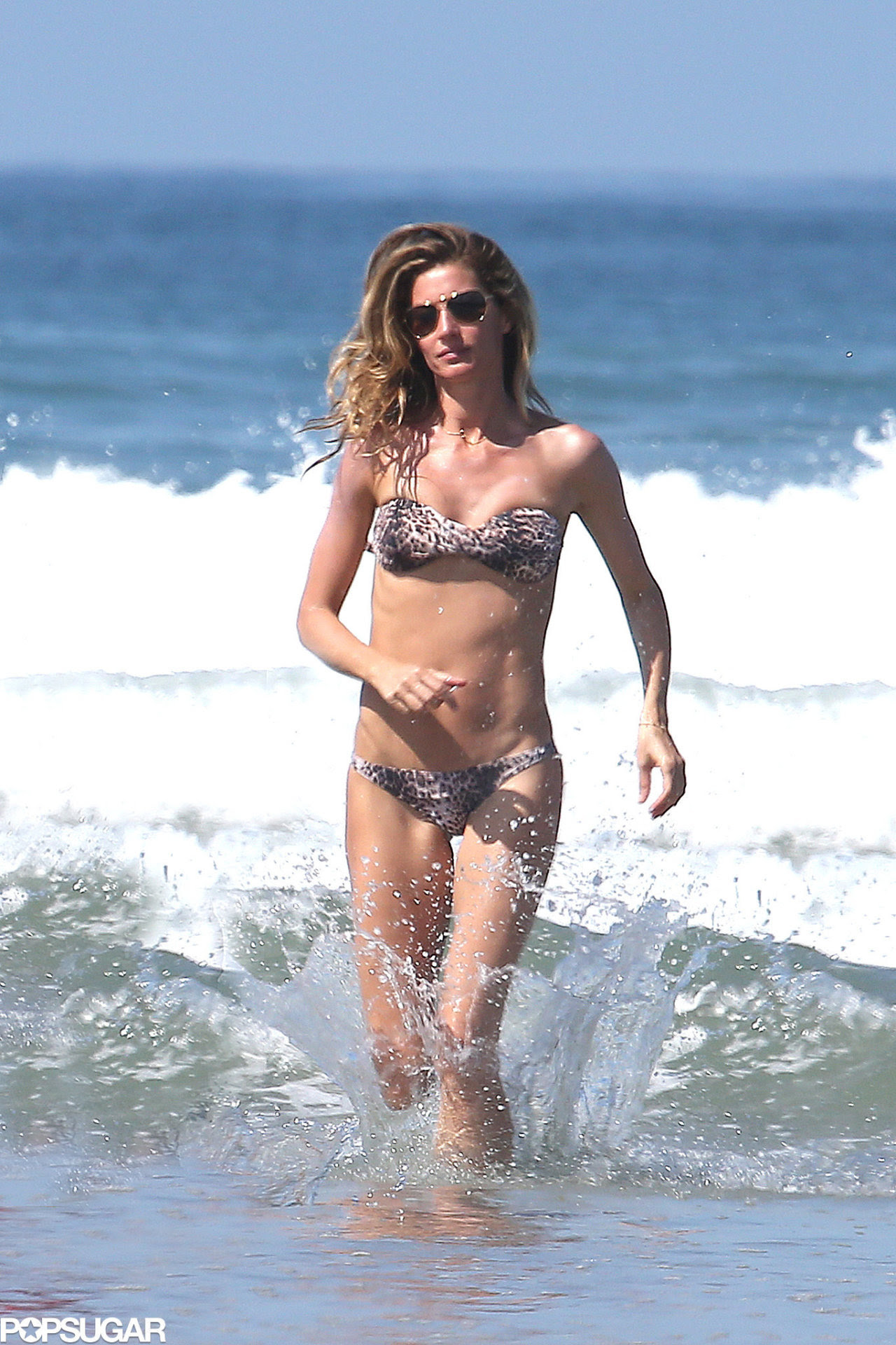 GISELE on the beach in Costa Rica with Tom….
