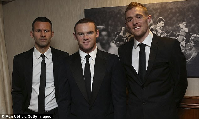 Cheer up, Ryan: A rather glum looking Giggs poses for a picture with team-mates Rooney and Fletcher