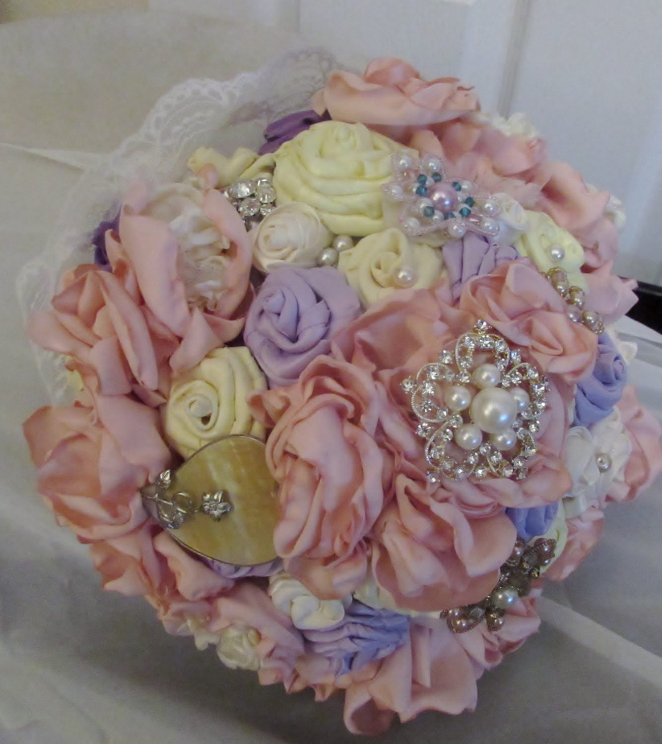 Bridal bouquet with satin roses and peonies, brooches and pearls