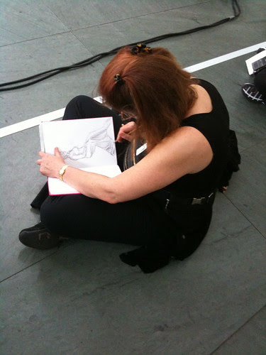 "Young woman sketching Marina Abramovic's ""The Artist Is Present"""