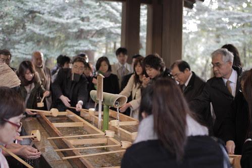People washing hands at temizuya