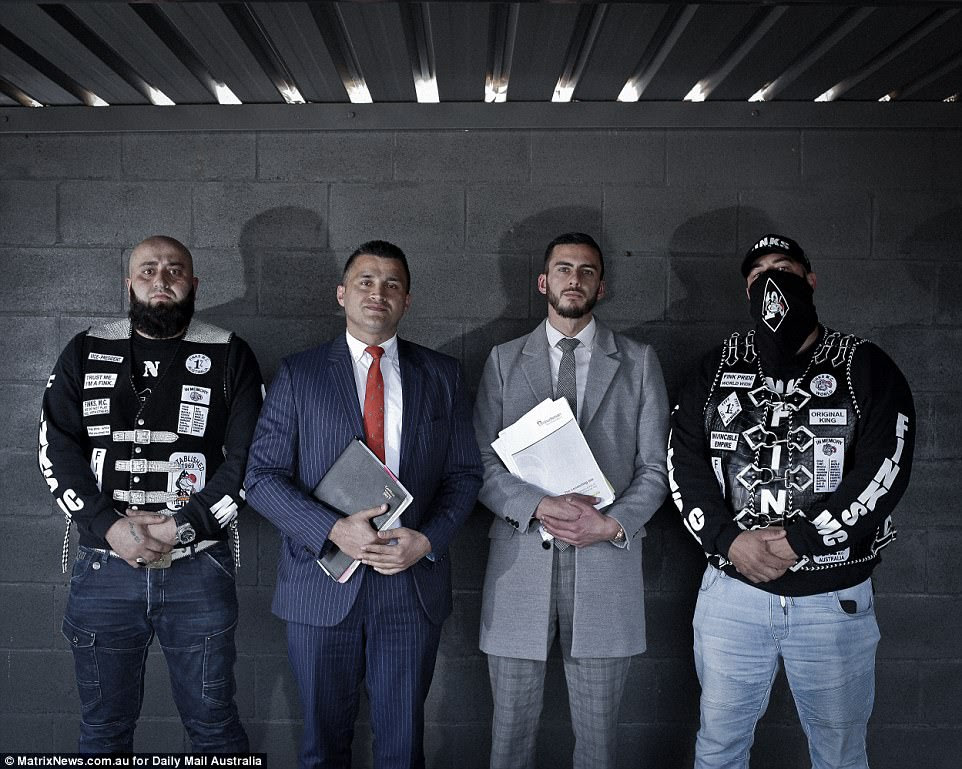 Members are not allowed to communicate with each other unless they are seeking legal advice. The Finks' lawyer Zemarai Khatiz, second from left, is pictured with his assistant centre flanked by two members