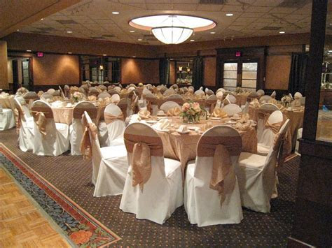 ivory chair covers with accent tie and table linens would