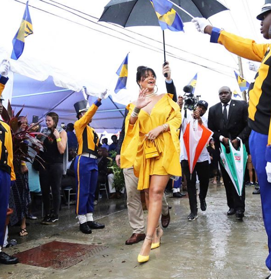 Rihanna wows in yellow at her street unveiling ceremony in Barbados