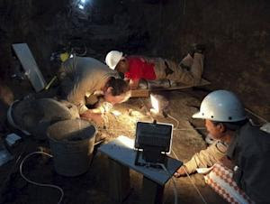 Handout file photo of INAH archaeologists working at …