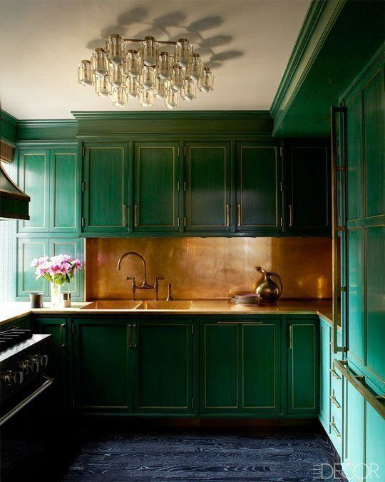 kitchen in Cameron Diaz' Manhattan apartment. Emerald cabinets and a brass backsplash