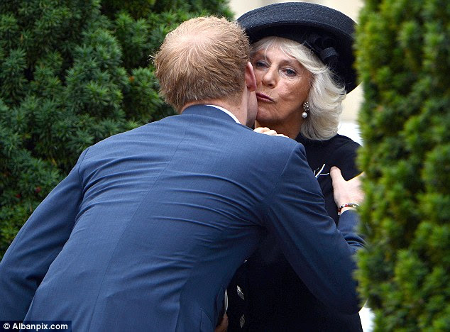 Fond farewell: Harry kisses the Duchess of Cornwall after the moving service in Essex today