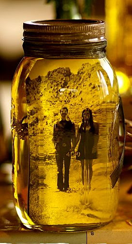 Put a picture in a mason jar and add olive oil!