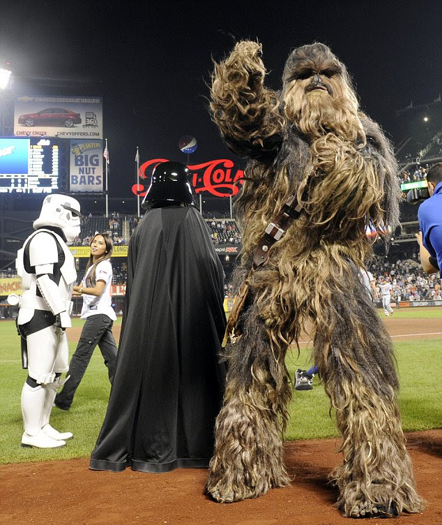 George Lucas has arranged promotional events throughout the world including this appearance of Chewbacca, Darth Vader and a lonely Stormtrooper at a baseball game in New York