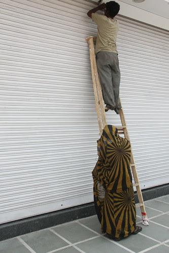 beneath the ladder of success a man climbs lies the forgotten woman by firoze shakir photographerno1