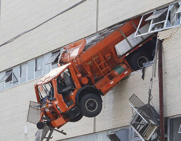 A salt-spreading truck rammed through the wall of a Sanitation Department repair shop in an 'unfortunate accident'