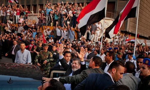 Crowds in Cairo's Tahrir Square for the swearing-in of the new President Mohamed Morsi on June 29, 2012. He pledged to work toward the release of an Egyptian cleric held in the United States. by Pan-African News Wire File Photos