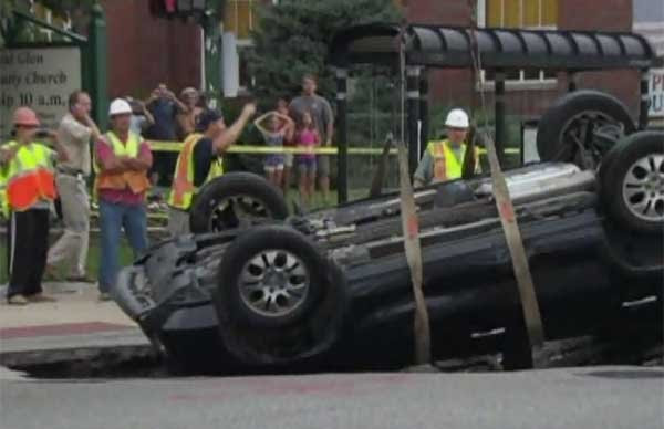 Man survives driving into sinkhole