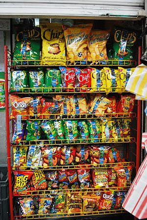 English: Rack with Mexican-brand snack food at...