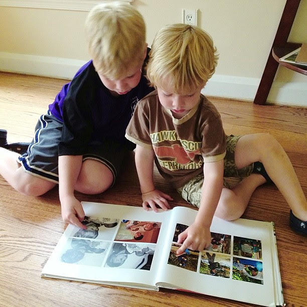 Walking into the room and finding big brother and little brother looking through a family photo album...#1000gifts