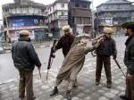 20 - 12 - 02 Indian forces drag an elderly Kashmiri during a