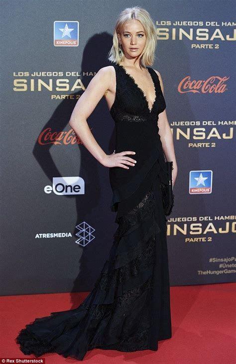 Jennifer Lawrence takes a dramatic tumble at Madrid