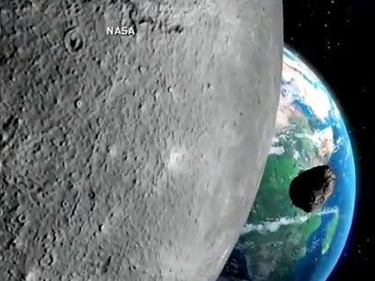 asteroid passing the moon