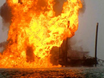 A Chevron oil rig in flames after an explosion. The incident occured in Bayelsa State after the government banned protests over objections to fuel price hikes. by Pan-African News Wire File Photos