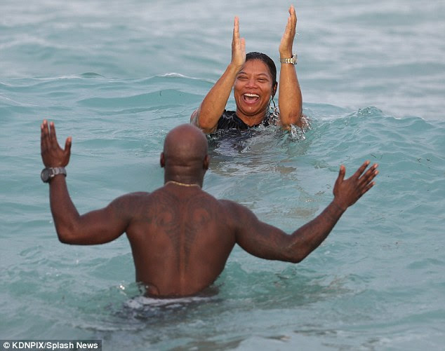 Big clap: Latifah gave a clap of approval in the water