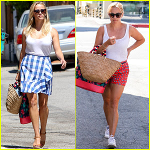 Reese Witherspoon Pairs Her White Tank with a Skirt & Shorts!