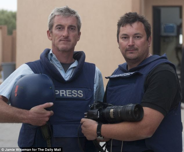 Lucky: Daily Mail writer Andrew Malone with staff photographer Jamie Wiseman after their ordeal on the streets of Misrata