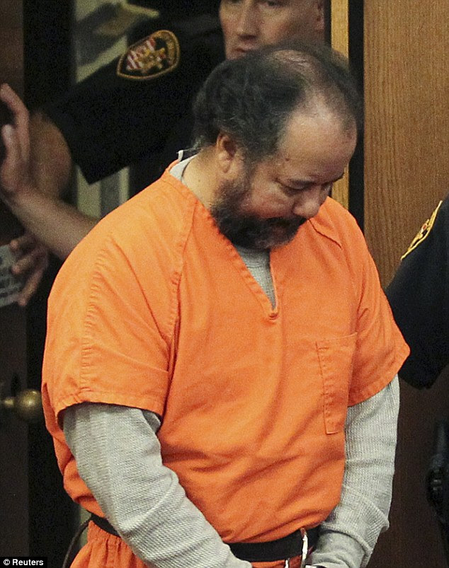 Plea Deal: Ariel Castro, 53, walks into the court room with his head down for a pre-trial hearing on charges including rape, kidnapping and murder in Cleveland, Ohio July 24, 2013