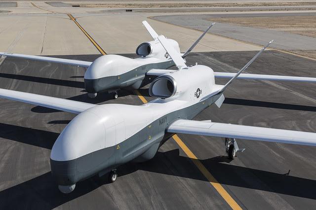 Northrop Grumman MQ-4C Tritons on the tarmac.