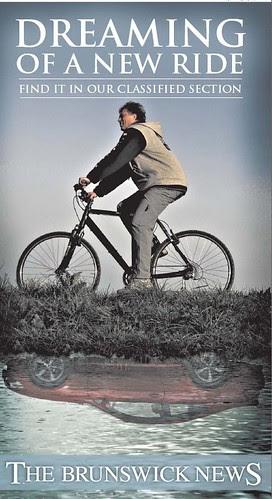 Buy a car, not a bicycle, Brunswick News ad