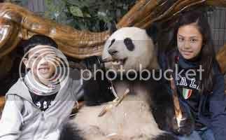 Kids with a panda bear
