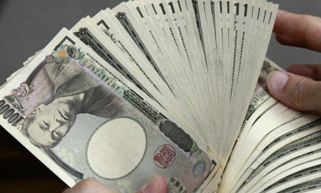 A bank teller counts 10,000 yen.