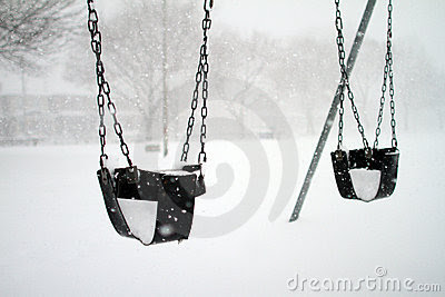 Baby swings covered with snow
