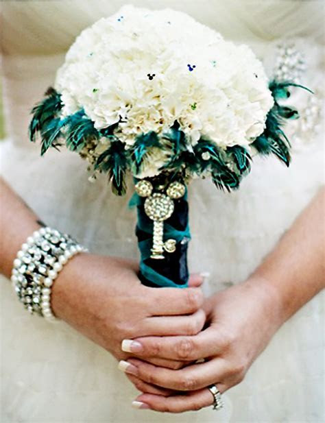 love this disney wedding bouquet with mickey mouse brooch