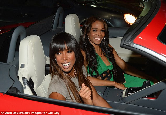 Reunion: Destiny's Child stars Kelly Rowland and Michelle Williams catch up as they attend Tuesday night's Jaguar and Gilt celebrate #MyTurnToJag event in Hollywood