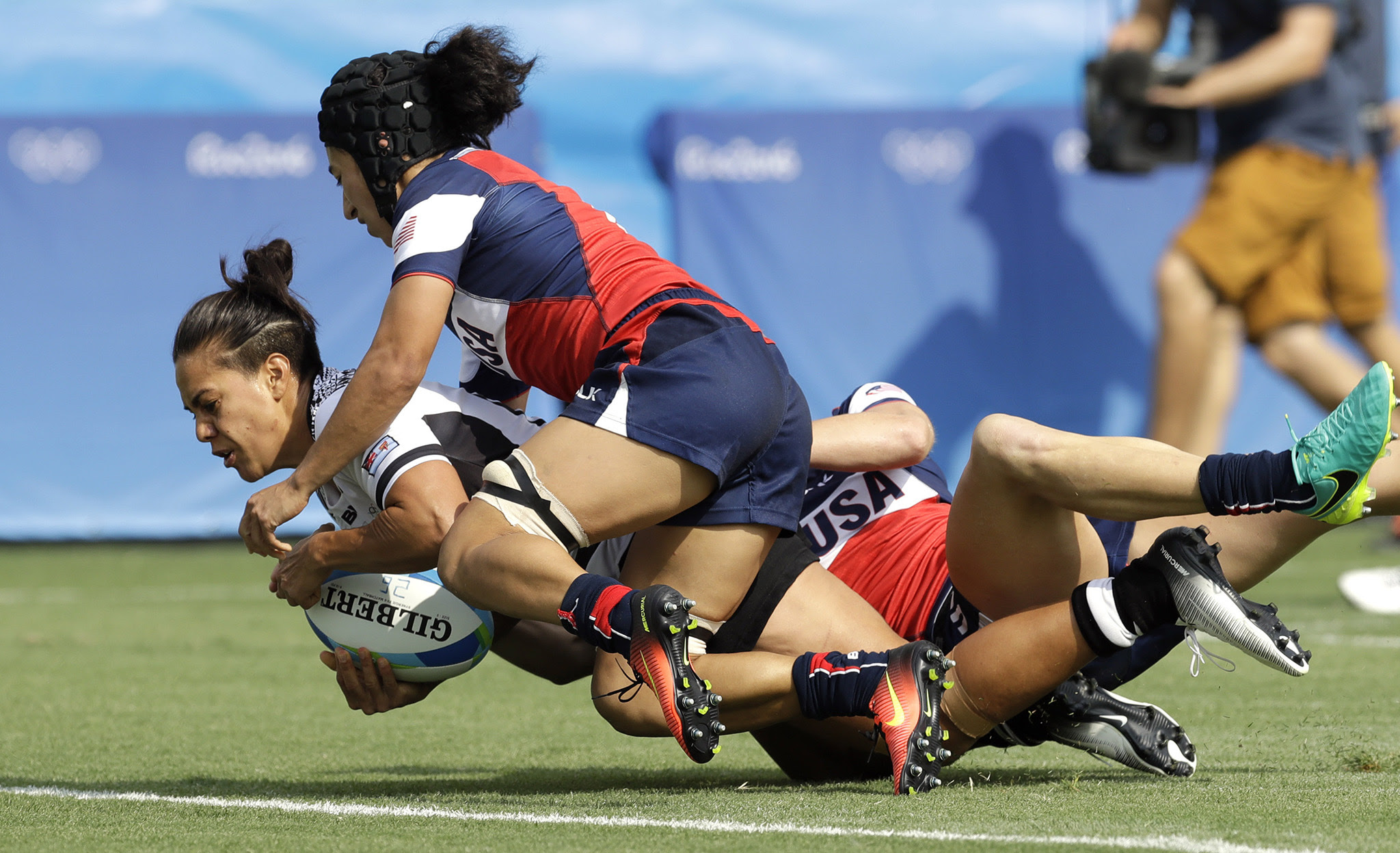 Fiji's Rebecca Tavo, left, scores a try as USA's Kelly Griffin, defends during the women's rugby sevens match at the Summer Olympics in Rio de Janeiro, Brazil, Monday, Aug. 8, 2016. (AP Photo/Themba Hadebe)