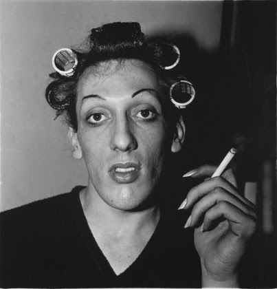 A young man in curlers at home on West 20th street, NYC, 1966, by Diane Arbus