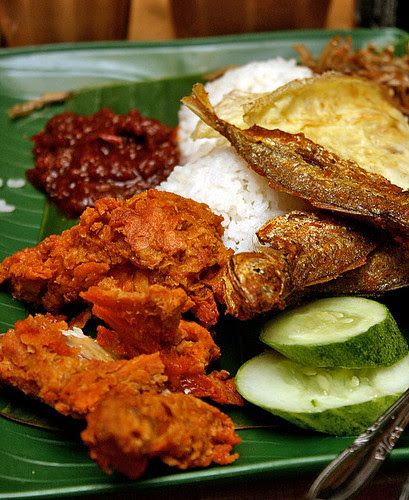 You can choose your nasi lemak toppings - here, fried chicken wing, ikan kuning and omelette (all in only S$3.50!)