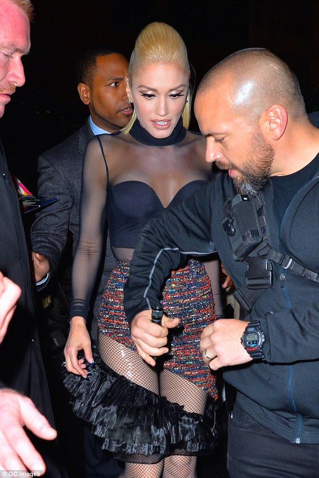 Heavily guarded: Gwen was flanked by her entourage as she made her way through the crowd