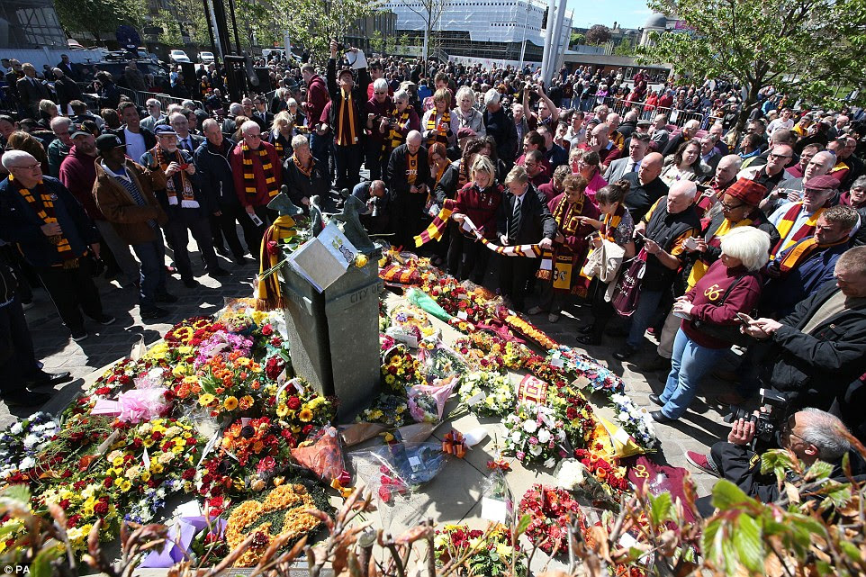 Thousands gather to remember football fans who died in ...