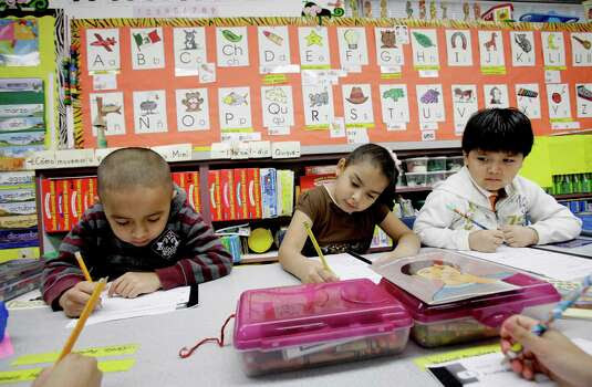 Bilingual students, if their native languages are nurtured instead of squelched, become high-functioning employees in the 21st Century economy. Kindergarden students Gael Alvarado, left, Perla Ortiz, center, and Yahir Perez do school work in a bilingual English-Spanish class at Hanby Elementary School in Mesquite, Texas, in 2011. Photo: LM Otero /Associated Press / AP
