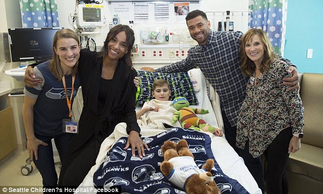 Big hearts: Russell Wilson and wife Ciara headed to Seattle Children's Hospital to surprise fans on Tuesday