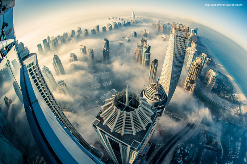 http://twistedsifter.com/2013/02/dubai-cityscape-aerial-with-fog/