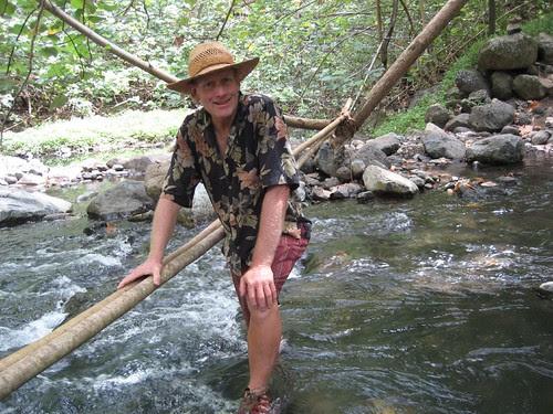 Peter crossing stream at Hakaui
