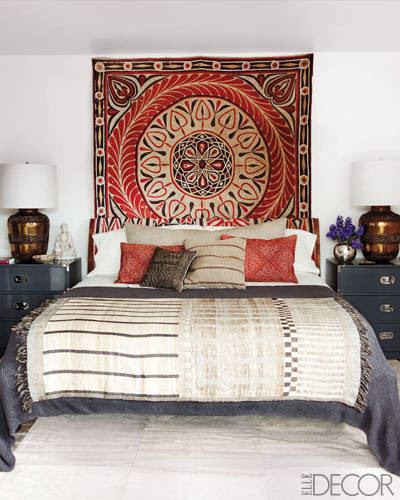 Grey's Anatomy star Ellen Pompeo enlisted designer Martyn Lawrence-Bullard to create a well-traveled look for her Hollywood Hills bedroom. Pompeo found the bed at one of her favorite Parisian stores, Caravane Chambre 19, and accessorized it with an antique Egyptian wall hanging, Moroccan-style brass lamps, an Indian throw, and 1950s West African pillows from Hollywood at Home.  Tour this home.